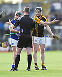 Enda Boyce of Cratloe and Tony Kelly of  Ballyea have a word with referee Wayne King during the county senior hurling final at Cusack Park. Photograph by John Kelly.
