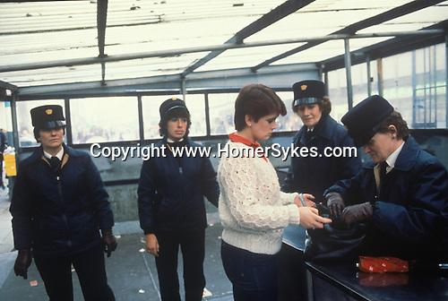 Northern Ireland The Troubles. 1980s. 1981, Female RUC policewomen seach  a shopper enterig sewcure area of Belfast.