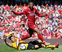 Liverpool's Georginio Wijnaldum is tackled by Wolverhampton Wanderers' Raul Jimenez<br /> <br /> Photographer Rich Linley/CameraSport<br /> <br /> The Premier League - Liverpool v Wolverhampton Wanderers - Sunday 12th May 2019 - Anfield - Liverpool<br /> <br /> World Copyright © 2019 CameraSport. All rights reserved. 43 Linden Ave. Countesthorpe. Leicester. England. LE8 5PG - Tel: +44 (0) 116 277 4147 - admin@camerasport.com - www.camerasport.com