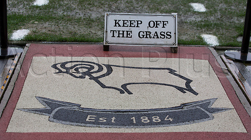 03.04.2015.  Derby, England. Skybet Championship. Derby versus Watford. Player entry to the pitch before the game with a 'keep off the grass' sign.