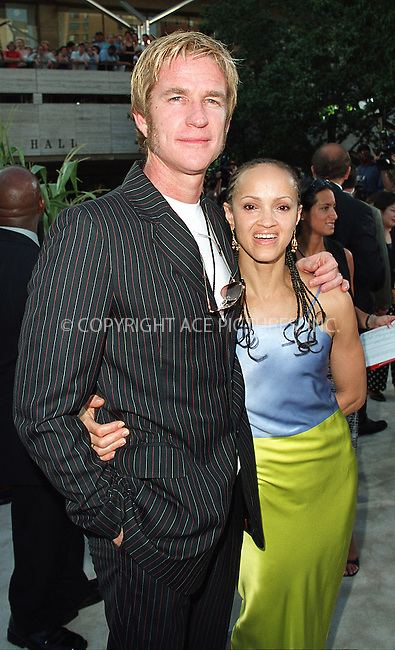 """Matthew Modine and wife Caridad arrive at the world premiere of Touchstone Pictures' movie, """"Signs"""" at Lincoln Center, New York. July 29, 2002. Please byline: Alecsey Boldeskul/NY Photo Press.   ..*PAY-PER-USE*      ....NY Photo Press:  ..phone (646) 267-6913;   ..e-mail: info@nyphotopress.com"""