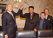 Michael J. Fox, right center, and Mohammad Ali, left center, are welcomed by United States Senate Appropriations Subcommittee on Labor and HHS Chairman Tom Harkin (Democrat of Iowa), left and Ranking Member Arlen Specter (Republican of Pennsylvania), right, before they testify for the hearing on Parkinson's Disease on Capitol Hill in Washington, DC on May 22, 2002.  Both Mr. Fox and The Champ advocated for increased funding to the National Institutes of Health (NIH) for Parkinson's research.<br /> Credit: Ron Sachs / CNP