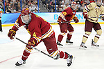 07 APR 2012:  Chad Billins (4) of Ferris State University keeps an eye on the puck against Boston College during the Division I Men's Ice Hockey Championship held at the Tampa Bay Times Forum in Tampa, FL.  Boston College defeated Ferris State 4-1 to win the national title.  Matt Marriott/NCAA Photos
