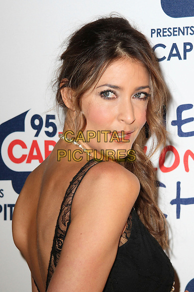 LISA SNOWDON .Capital Rocks at the Battersea Evolution, London, England, December 2nd 2008..portrait headshot back over shoulder black lace dress pearl necklace .CAP/JIL.©Jill Mayhew/Capital Pictures