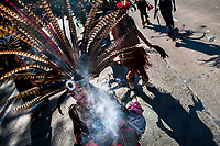 A Mexican woman, wearing a large feather headgear, performs an ancient Aztec Death Worship dance on the street during the Day of the Dead procession in Mexico City, Mexico, 29 October 2016. Day of the Dead (Día de Muertos), a syncretic religious holiday combining the death veneration rituals of the ancient Aztec culture with the Catholic practice, is celebrated throughout all Mexico. Based on the belief that the souls of the departed may come back to this world on that day, people gather at the gravesites in cemeteries praying, drinking and playing music, to joyfully remember friends or family members who have died and to support their souls on the spiritual journey.
