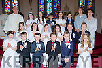 Pupils from Knockaderry NS, Farranfore with Fr Tadhg O'Dochertaigh, Anne Daly principal and teacher Sheila O'Leary at their First Holy Communion in Firies on Saturday