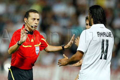 19.08.2010 Europa League SK Sturm Graz v Juventus Play Off for qualification. Picture shows the Referees Cueneyt Cakir Door and Amauri Juventus