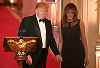 United States President Donald J. Trump (L) holds hands with First Lady Melania Trump after opening remarks at a White House Historical Association dinner at the White House, May 15, 2019, in Washington, DC. The organization's goal is to promote the public's understanding, appreciation and enjoyment of the White House.  <br /> CAP/MPI/CNP/MT<br /> ©MT/CNP/MPI/Capital Pictures