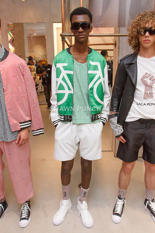 "Models pose in outfits from the Ricardo Seco Spring Summer 2019 ""Vision"" collection fashion presentation at Flying Solo, in New York City, on July 9, 2018; during New York Fashion Week: Men's Spring Summer 2019."