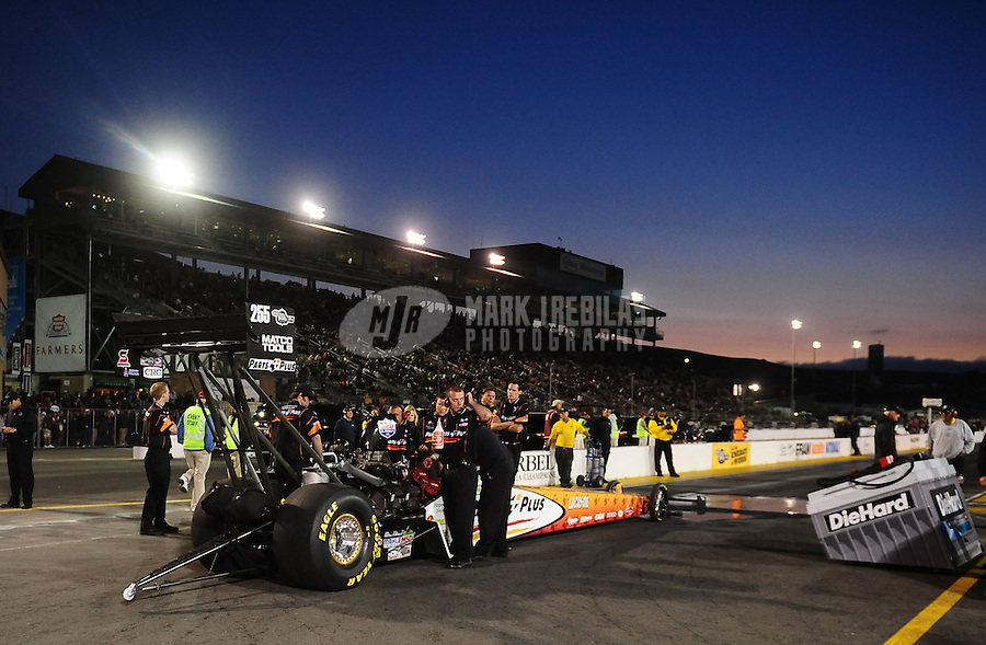Jul. 29, 2011; Sonoma, CA, USA; Crew members for NHRA top fuel dragster driver Clay Millican during qualifying for the Fram Autolite Nationals at Infineon Raceway. Mandatory Credit: Mark J. Rebilas-