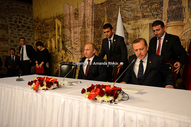 Russian President Vladimir Putin and Turkish Prime Minister Recep Tayyip Erdogan are seated for a joint press conference at the Turkish Prime Minister's office at Dolmabahce Palace in Istanbul, Turkey on December 3, 2012.