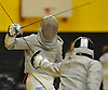 Bobby Spathis of Commack, left, and Emanuel Santiago of Brentwood duel in sabre during a boys fencing match at Commack High School on Friday, Dec. 2, 2016. Spathis won the bout 5-1.