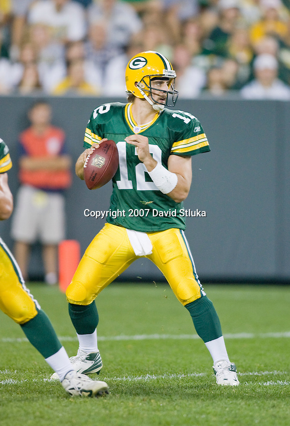 Quarterback Aaron Rodgers #12 of the Green Bay Packers looks for a receiver during an NFL football game against the Jacksonville Jaguars at Lambeau Field on August 23, 2007 in Green Bay, Wisconsin. The Jaguars beat the Packers 21-13. (Photo by David Stluka)