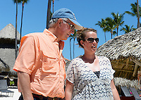Eric Griffiths walks his daughter, Allison, up the aisle during Thursday's run-through in Punta Cana