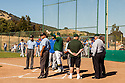 San Marin coach Mark Whitburn discusses the ground rules with the officials and the Acalanes High coaches before the NCS Division 3 final at San Marin High School on June 6, 2011. The officials suspended the game due to darkness after 10 innings. NCS officials declared both teams Co-champions.