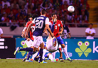SAN JOSE, COSTA RICA - September 06, 2013: Clint Dempsey (8) of the USA MNT kicks the ball over Johnny Acosta (2)of the Costa Rica MNT during a 2014 World Cup qualifying match at the National Stadium in San Jose on September 6. USA lost 3-1.