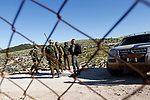 Israeli security forces secure the area as Israeli bulldozers demolishing water network on a Palestinian land near the village of Yatta, south of the West Bank city of Hebron, February 13, 2019. Israeli authorities regularly demolish constructions and makeshift infrastructure of Palestinian residents who do not have needed permits to build or establish infrastructure in area C which in the occupied West Bank. Photo by Wisam Hashlamoun