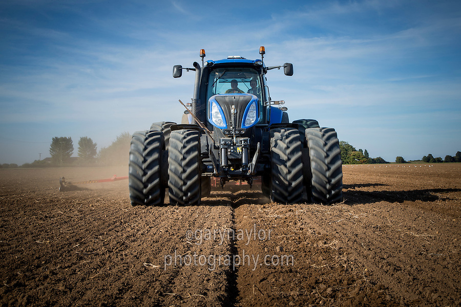 New Holland tractor fitted with front and rear dual wheels, drilling winter wheat with 6m Vadersatd drill - September, Lincolnshire