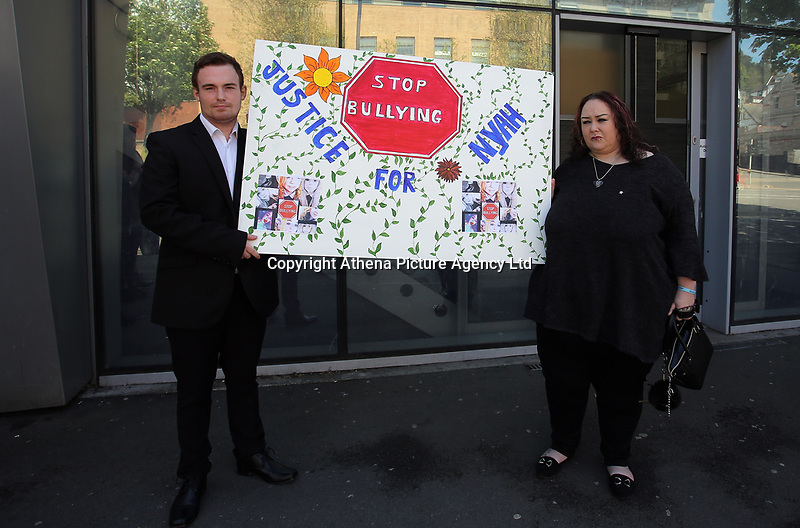 """Pictured L-R: Jordan Clements with Dominique Williams, outside Swansea Magistrates Court. Tuesday 02 May 2017<br /> Re: A man who sent abusive messages to girls he believed had bullied his late sister has been spared jail by a judge, who said he had been """"irrational with grief"""".<br /> Jordan Clements' 14-year-old sister Nyah James was found dead at her home in Blaenymaes, Swansea, in February.<br /> Swansea Magistrates' Court heard Clements later targeted four girls.<br /> The 20-year-old pleaded guilty to two counts of harassment and two counts of sending offensive communications.<br /> Clements was ordered to complete a 125-hour community order as well as 15 days of rehabilitation.<br /> District Judge Neale Thomas said he could have sent Clements to prison because of the targeted and frightening online messages he sent to his four victims, which the court heard were abusive and threatening.<br /> However, Judge Thomas said the defendant had become """"irrational with grief"""" following Nyah's death."""