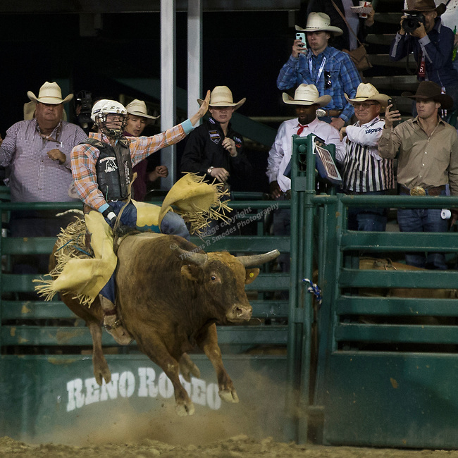 Cullen Telfer competes in the Bull Riding event during the Reno Rodeo on Sunday, June 23, 2019.