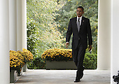 United States President Barack Obama walks from the Oval Office to make a statement in the Rose Garden of the White House in Washington, D.C. following the government of Libya's announcement of the death of former dictator Colonel Muammar Qaddafi..Credit: Yuri Gripas / Pool via CNP
