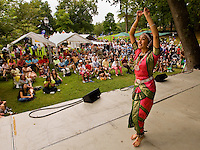 A dancer performs for the crowds at the Festival in the Park. For more than four decades, Charlotte's annual Festival in the Park has brought music, art and fun to Charlotteans and visitors. The festival has been chosen as one of Sunshine Artists Magazine's 200 Best Festivals.