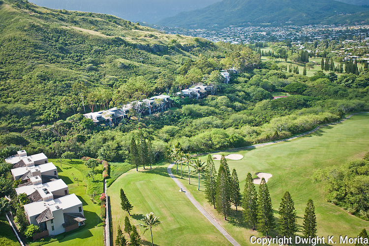 Bluestone Condominiums - the 17th hole and the 18th tee box of the Mid-Pacific Country Club in the foreground. The line of town houses in the center of the photo are the Kamahele street homes.