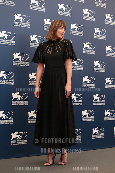 Dakota Johnson at the photocall for Black Mass at the 2015 Venice Film Festival.<br /> September 4, 2015  Venice, Italy<br /> Picture: Kristina Afanasyeva / Featureflash