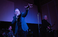 17 DEC 2014 - STOWMARKET, GBR - Dr Feelgood vocalist Robert Kane performing during a gig at the John Peel Centre for Creative Arts in Stowmarket, Suffolk, Great Britain (PHOTO COPYRIGHT © 2014 NIGEL FARROW, ALL RIGHTS RESERVED)