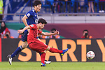 Nguyen Cong Phuong of Vietnam (front) attempts a kick for scores his goal during the AFC Asian Cup UAE 2019 Quarter Finals match between Vietnam (VIE) and Japan (JPN) at Al Maktoum Stadium on 24 January 2018 in Dubai, United Arab Emirates. Photo by Marcio Rodrigo Machado / Power Sport Images