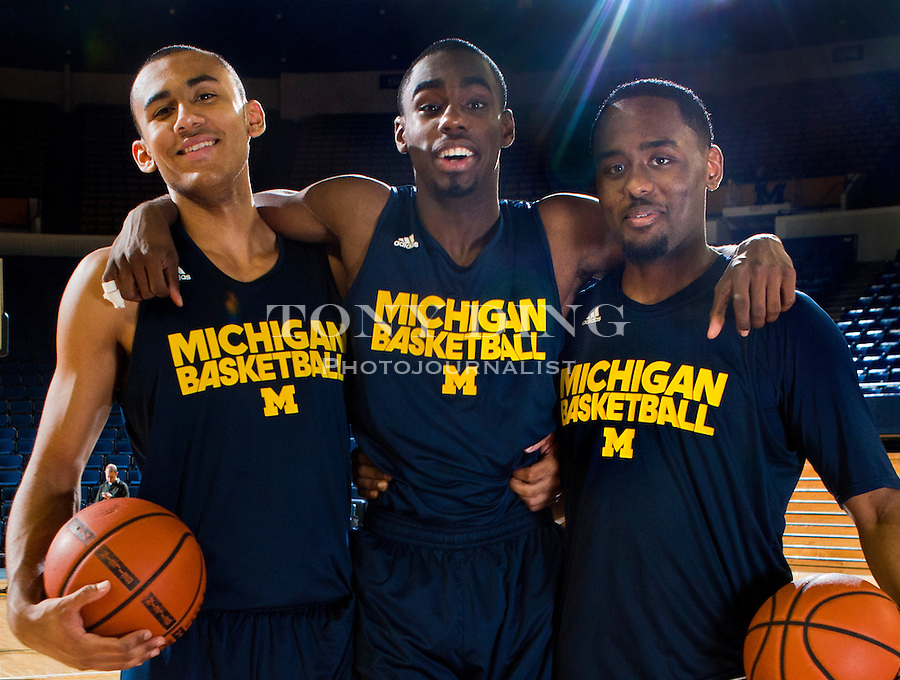 Michigan forward Jon Horford, left, and guards Tim Hardaway, Jr., center, and Jordan Dumars, right, pose for pictures after a team practice, Thursday, Nov. 11, 2010, at Crisler Arena in Ann Arbor, Mich. Hardaway, Jr. is the son of former Miami Heat All-star Tim Hardaway, Dumars is the son of former Detroit Pistons All-star and current President of Pistons Basketball Joe Dumars, and Horford is the son of former Milwaukee Bucks' Tito Horford and brother to the Atlanta Hawks' Al Horford. (AP Photo/Tony Ding)