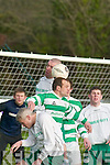 Outta my way! Killarney Celtic central defender Donagh Barry rises highest to head clear as Carraig United centre forward Tom Fitzgerald becomes the filling in the sandwich.   Copyright Kerry's Eye 2008