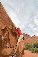Bouldering along the Colorado River, near Moab, South East Utah,