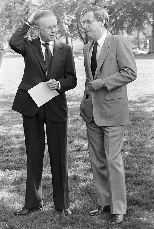 Sen. Paul Coverdell, D-Ga., and Sen. Mitch McConnell, R- Ky., talk about legal reform on April 27, 1995. (Photo by Maureen Keating/CQ Roll Call)