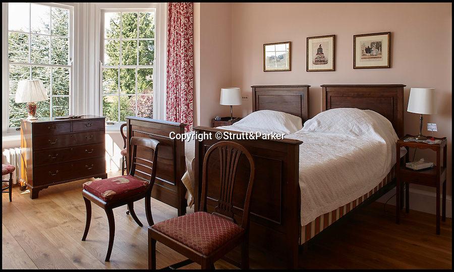 BNPS.co.uk (01202 558833)<br /> Pic: Strutt&Parker/BNPS<br /> <br /> One of the bedrooms.<br /> <br /> A striking Georgian manor house that once hosted the scandalous menage-a-trois of Admiral Horatio Lord Nelson, his lover and her husband is on the market for £4.25million.<br /> <br /> The love triangle stayed at the property a couple of times in about 1801-1802, when Lord Nelson and Lady Emma Hamilton were two of the most famous people in the UK.<br /> <br /> Fir Hill was bought by the admiral's friend and colleague Captain Charles Powell Hamilton, who was also the cousin of Emma's husband Sir William Hamilton, in 1797.<br /> <br /> The house is in a picturesque spot in the South Downs National Park, at the heart of the Meon Valley in the village of Droxford, Hants.