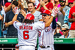 29 June 2017: Washington Nationals catcher Jose Lobaton greets Anthony Rendon at the dugout after Rendon hits a two run homer in the 7th inning against the Chicago Cubs at Nationals Park in Washington, DC. The Cubs rallied against the Nationals to win 5-4 and split their 4-game series. Mandatory Credit: Ed Wolfstein Photo *** RAW (NEF) Image File Available ***
