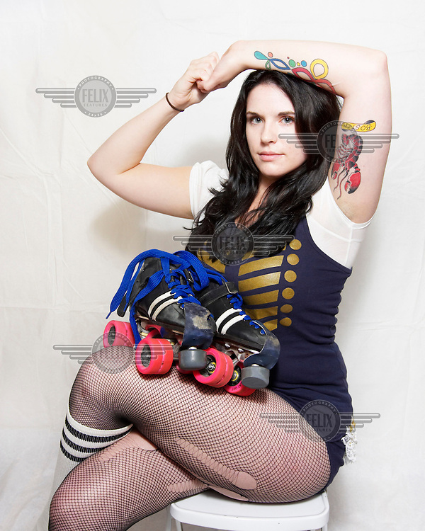 Harlot Fevah, of the roller derby team, the Boston Derby Dames. Roller derby is an American contact sport, popular with young women, which combines both athleticism and a satirical punk third-wave feminism aesthetic.