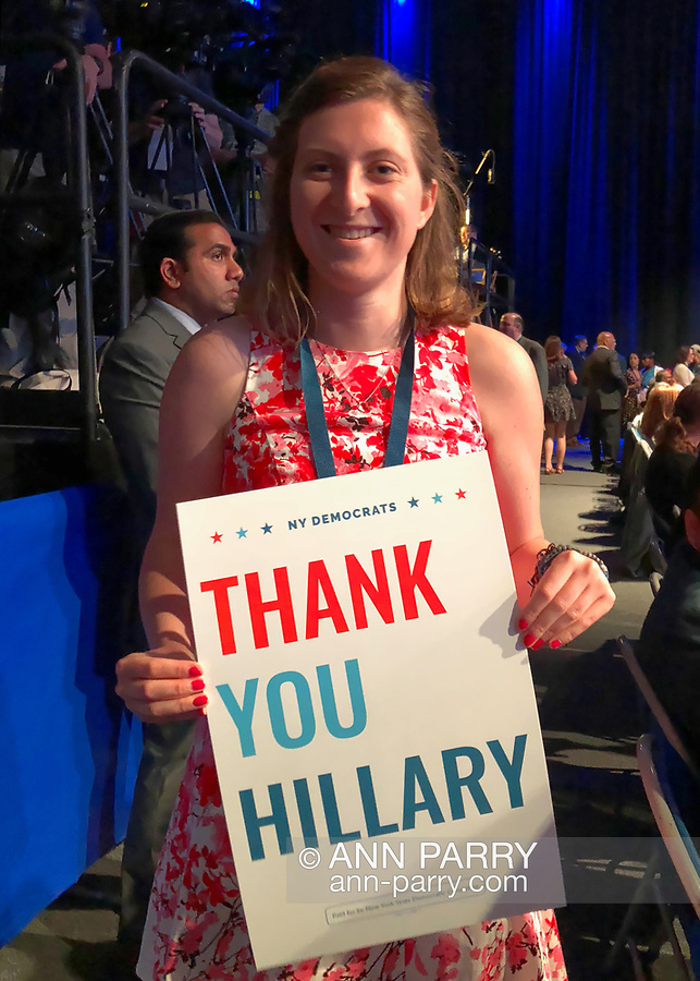 Hempstead, New York, USA. May 23, 2018. ABBY, a guest, holds THANK YOU HILLARY poster during Day 1 of NYS Democratic Convention, held at Hofstra University.