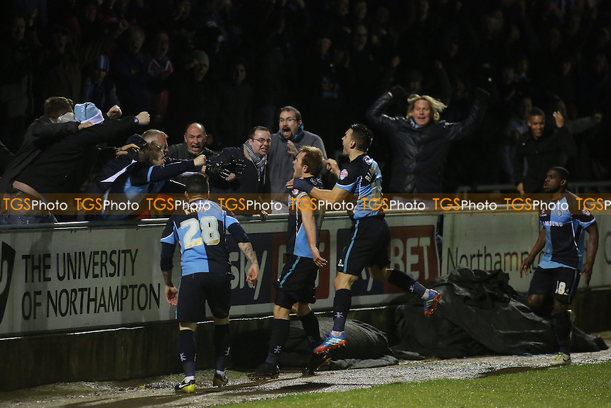 Stuart Lewis celebrates scoring the third goal with the Wycombe fans - Northampton Town vs Wycombe Wanderers - Sky Bet League Two Football at the Sixfields Stadium, Northampton - 21/12/13 - MANDATORY CREDIT: Paul Dennis/TGSPHOTO - Self billing applies where appropriate - 0845 094 6026 - contact@tgsphoto.co.uk - NO UNPAID USE