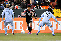 D.C. United midfielder Andy Najar (14) goes against Sporting Kansas City midfielder Roger Espinoza (15) right and defender Seth Sinovic (16) Sporting Kansas City defeated D.C. United  1-0 at RFK Stadium, Saturday March 10, 2012.