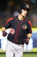 Daniel Ortiz (39) of the Rochester Red Wings rounds the bases after hitting a home run against the Charlotte Knights at BB&T Ballpark on June 5, 2014 in Charlotte, North Carolina.  The Knights defeated the Red Wings 7-6.  (Brian Westerholt/Four Seam Images)