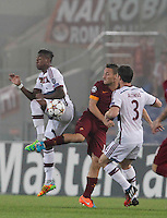 Bayer's Jerome Boateng challanges  Roma's Francesco Totti   during the Champions League Group E soccer match betchween As Roma and FC Bayern Munchen at the Olympic Stadium in Rome october 21 , 2014.