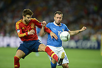 01.07.2012 Kiev, Ukraine.  Spain's Gerard Pique (L) and Italy's Antonio Cassano challenge for the ball during the UEFA EURO 2012 final soccer match Spain vs. Italy at the Olympic Stadium in Kiev, Ukraine, 01 July 2012.
