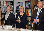 Huntington, New York, U.S. - August 6, 2014 - HILLARY RODHAM CLINTON arrives at book signing to promote her new memoir, Hard Choices, at Book Revue in Huntington, Long Island, during a nationwide tour. At left of her are Book Revue co-owners, brothers RICHARD KLEIN, and behind him ROBERT KLEIN. Clinton's book is about her four years as America's 67th Secretary of State and how they influence her view of the future.