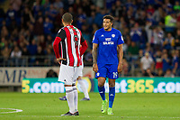 Nathaniel Mendez-Laing of Cardiff City speaks to Leon Clarke of Sheffield United after scoring his side's second goal during the Sky Bet Championship match between Cardiff City and Sheffield United at Cardiff City Stadium, Cardiff, Wales on 15 August 2017. Photo by Mark  Hawkins / PRiME Media Images.