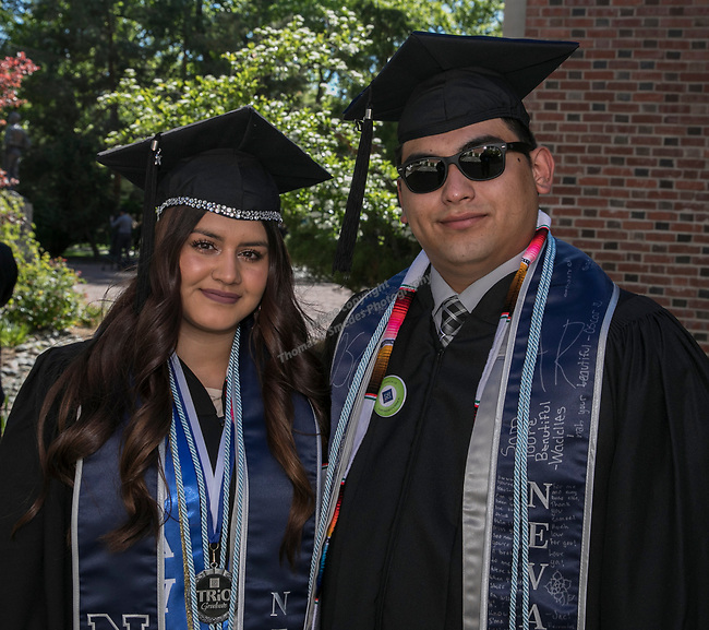 Carina Gomez and Samuel Rosales during the University of Nevada College of Agriculture, Biotechnology & Natural Resources and College of Education graduation ceremony on Friday evening, May 19, 2017.