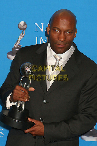 JOHN SINGLETON .At the NAACP Image Awards, held at the The Shine Auditorium, Los Angeles, California, USA, .25 February 2006..half length press room trophy.Ref: ADM/BP.www.capitalpictures.com.sales@capitalpictures.com.©Byron Purvis/AdMedia/Capital Pictures.