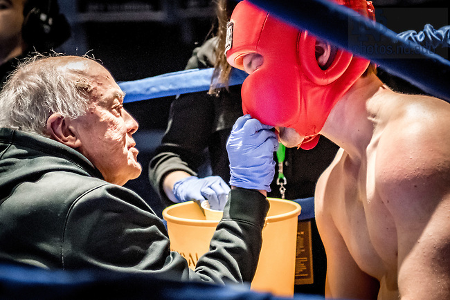 "March 3, 2017; Rev. Brian Daley, S.J. tends to Ryan ""Eat at Yaz's"" Richelsen during the HeavyWeight bout. (Photo by Matt Cashore/University of Notre Dame)"