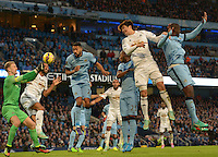 Picture by Howard Roe/AHPIX.com. Football, Barclays Premier League; <br /> Manchester City v Swansea City ;22/11/2014 KO 3.00 pm <br /> Etihad Stadium;<br /> copyright picture;Howard Roe;07973 739229<br /> Swansea's  Ki Sung Yueng header is saved by  Manchester's  keeper Joe Hart