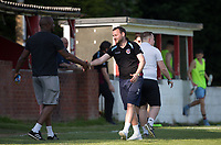Tuffley Rovers manager Mark Pritchett shakes hands with Marcus Richardson, manager of Flackwell Heath at full time during the UHLSport Hellenic Premier League match between Flackwell Heath v Tuffley Rovers at Wilks Park, Flackwell Heath, England on 20 April 2019. Photo by Andy Rowland.